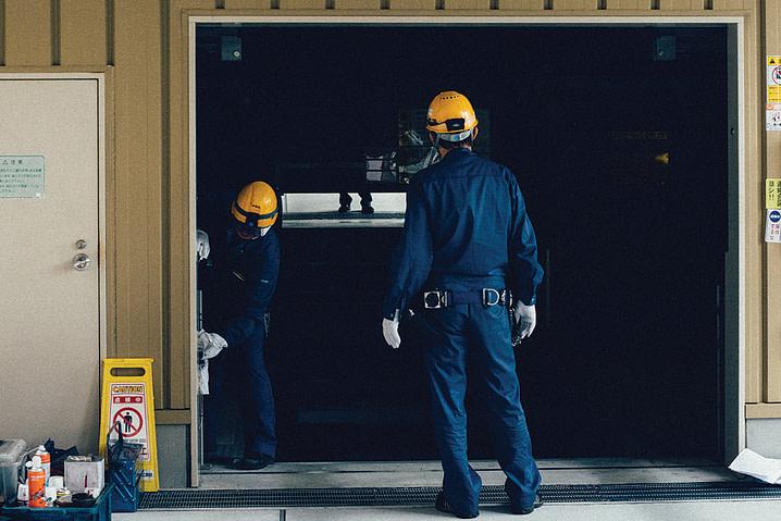 Discount Door Service men working.