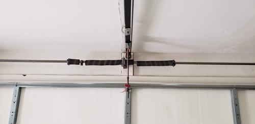 2 broken garage door springs